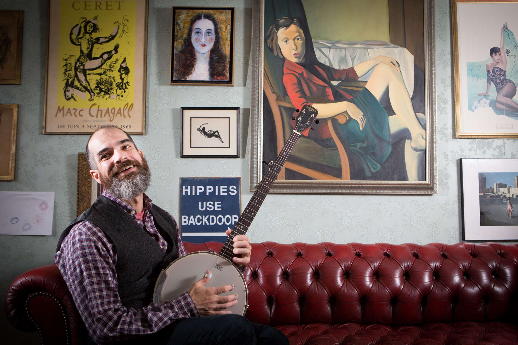 Art director and amateur banjo player photographed in his home in the Village in Manhattan.
