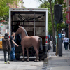 A prop from a Kentucky Derby party gets loaded back onto a truck on 4th Street between 2nd and Bowery