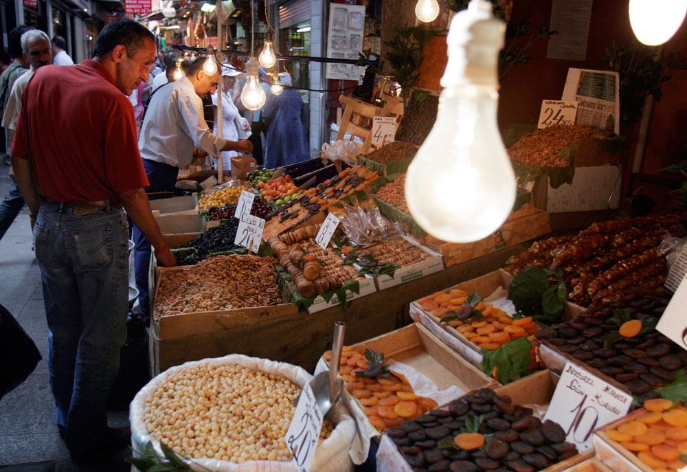 A man shops for dried fruits and nuts sold at a stand in the Istanbul Market.