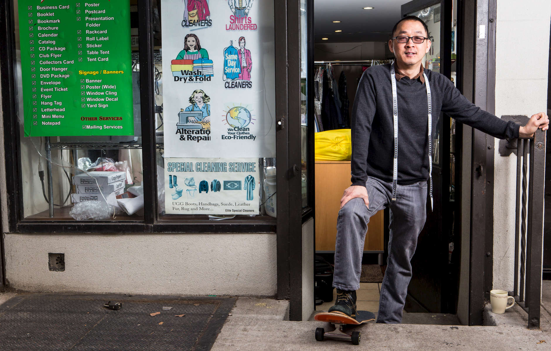 Michael Lam owner of D&M Cleaners between 1st and 2nd Ave. in front of his business. Michael rides a skateboard and does magic tricks too.