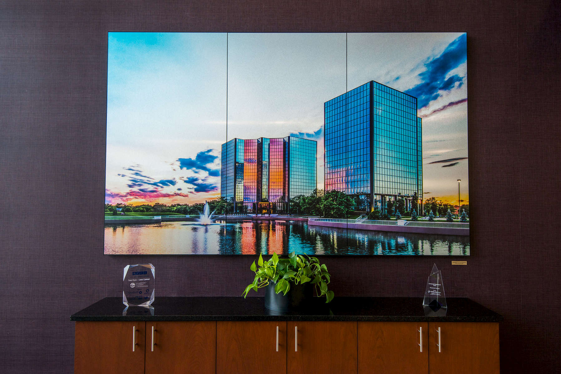 Three panels on brushed aluminum equalling an 8'x5' presentation.  Custom trim frame surrouding custom photography of Shamrock Towers in Overland Park, KS commissioned by client.