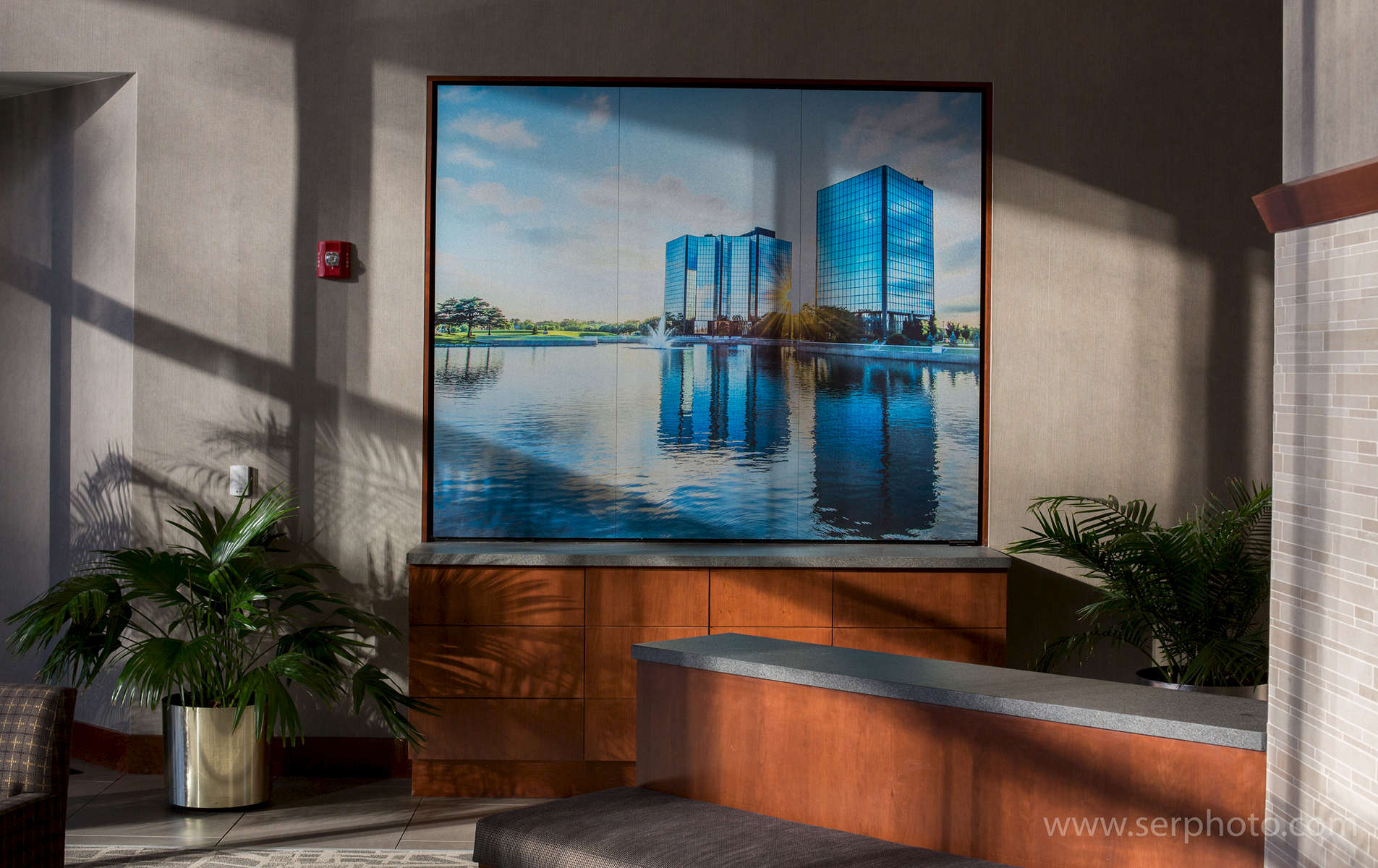 Three 27x69{quote} panels on brushed aluminum; custom mounting in recessed wall inset.  Custom photography of Shamrock Towers in Overland Park, KS commissioned by client. Client: Ryan Transportation Services
