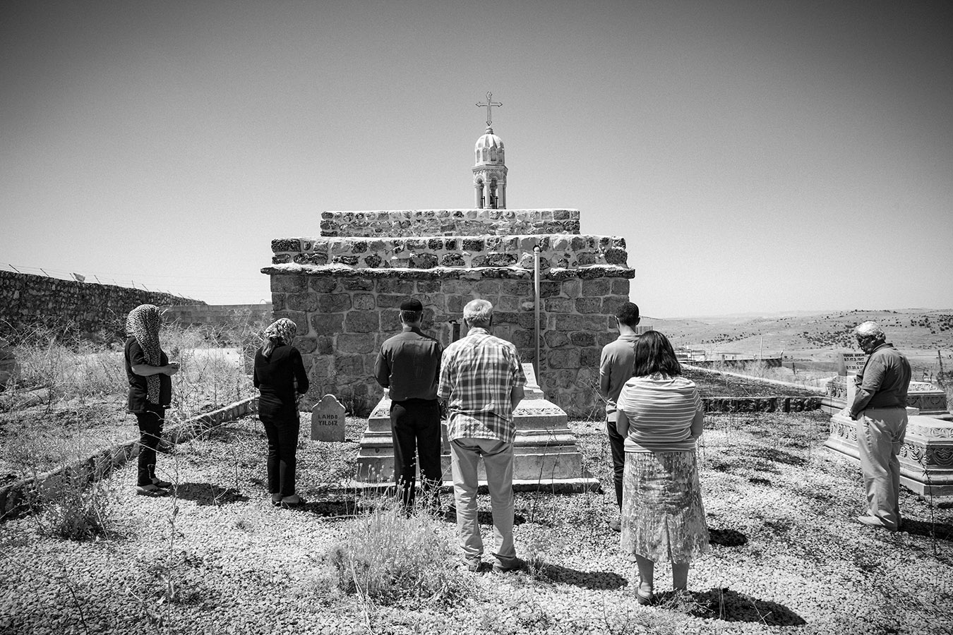 Syriacs who are visiting their village from abroad pray for their passed away ones at Aynwardo village at Mort Smuni Church,Tur Abdin region.The Syriacs of Tur Abdin are an ancient people from northern Mesopotamia that was among the first civilizations in the world to adopt Christianity. Also known as Assyrians or Arameans, they still speak the Aramaic language of Jesus Christ. Their homeland is a region in southeastern Turkey known as Tur Abdin (Mountain of the Servants of God). The struggles of an exiled Christian people trying to return to its homeland in order to save its ancient faith from assimilation and extinction.The photos were taken our research trips to the Tur Abdin region in the previous years.