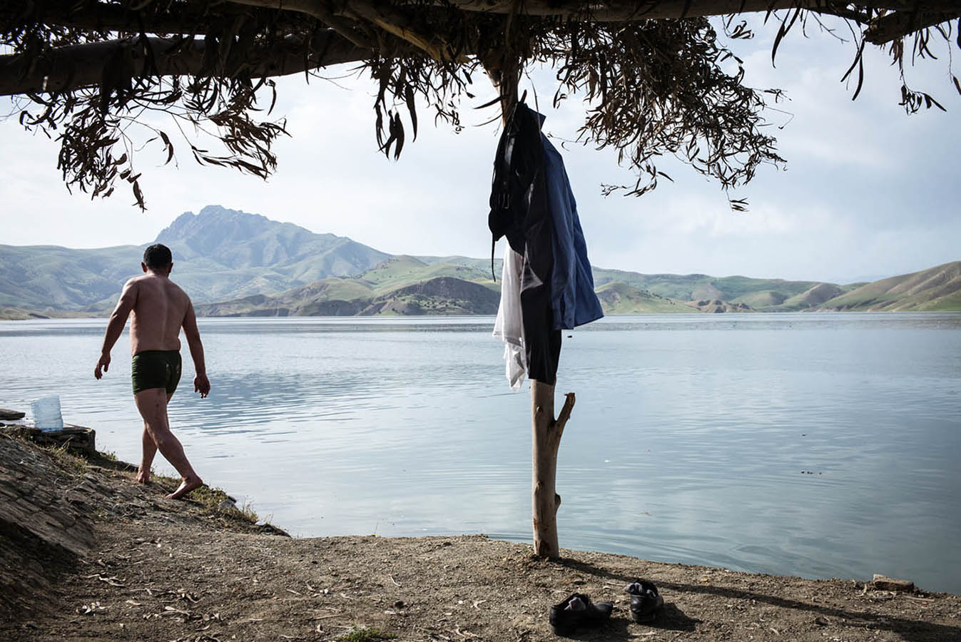A man gets ready to swim at the Dukan Lake in Suleymaniyah.