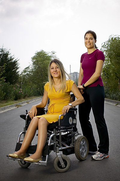 Itir Erhart(right) runs to raise money for battery powered wheelchairs for spinal cord praylse people.Asuman Uras is one of the user of these wheelchairs by the help.