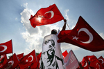 Pro secular demonstrators hold portraits of modern Turkeys founder Ataturk, shout slogans and wave Turkish flags during the demonstration.