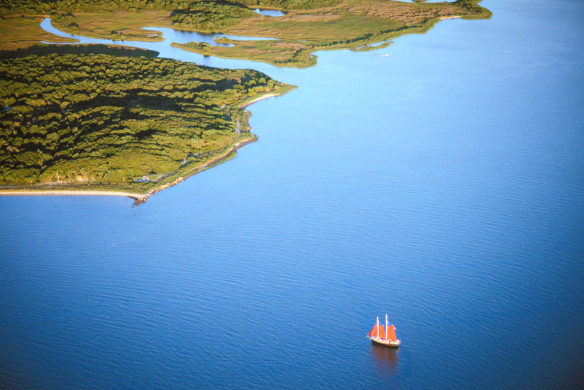 aerial view of sailing in Pamlico Sound by the Ocracoke Island coastline