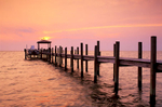 Boat dock extends into Pamlico Sound at sunset