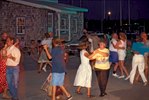 Island residents and visitors at Friday night dockside square dance on Ocracoke Island
