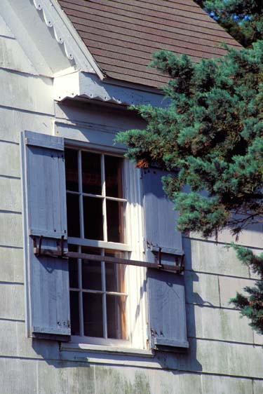 wooden window shutters snd architectural details of early 20th century house on Ocracoke Island