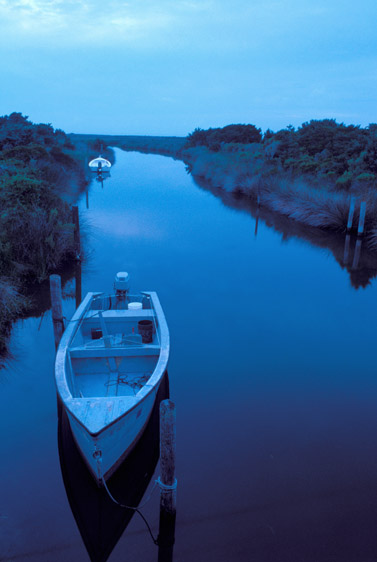 dawn light on boats docked on Pamlico Sound inlet, Ocracoke Island