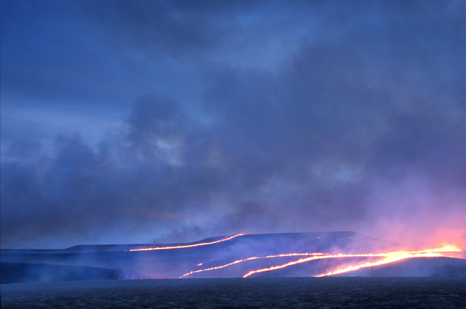 Photograph entitled Flint Hills burning at dusk