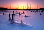 Sundown image of frozen-over man-made lake