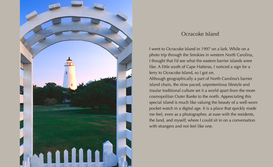 Ocracoke Lighthouse as seen at dawn through a private entrance gate