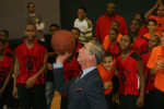 11-19-2007 - Prince Charles of Wales shoots a basketball and scores at the Harlem Children's Zone, to the surprise and delight of students who had just finished scrimmagiing.