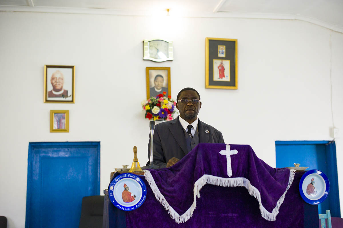 Rev. Joseph P. Letsholo, 53, the pastor and leader of St. John Apostlelic Faith Mission Church. He was photographed before the 11:30AM service started.