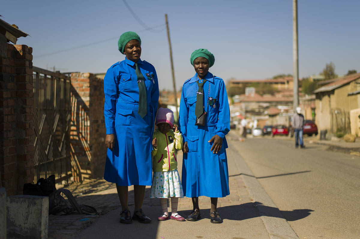Annah Zisongo, 43, with her child, Snethemba Zisongo, 4 and friend Grace Isikhalanga, 28.