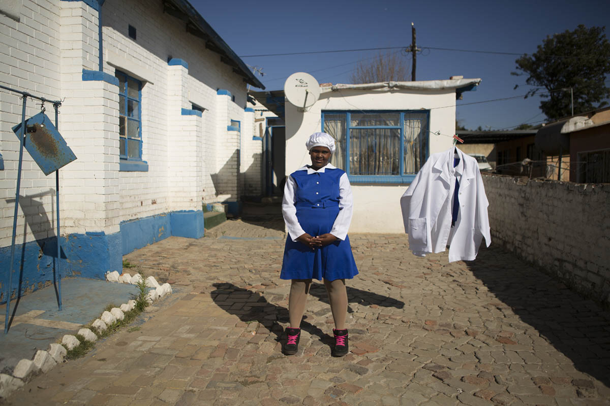 Boitumelo Pila, 12, in the yard of the church before the 11:30AM service at St. John Apostolic Faith Mission.