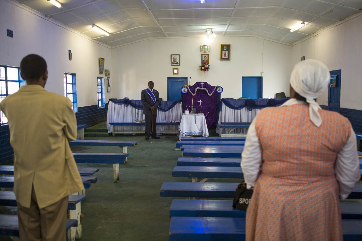 Rev. Joseph P. Letsholo, 53, leads the congregation in prayer before he preached the sermon of the 11:30AM service at St. John Apostolic Faith Mission Church.