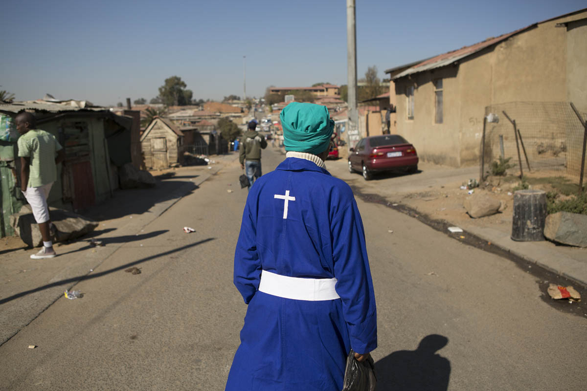 A woman heads for church mid-morning.