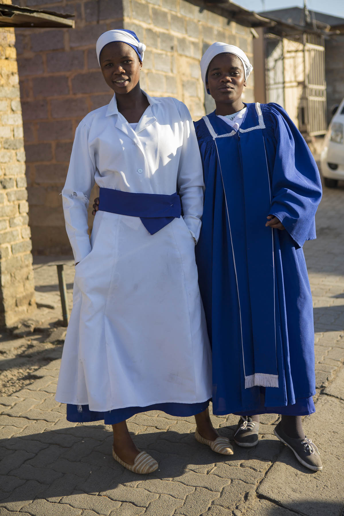 Sonelai Gakane, Sinazo Makunge, both 18 years old, were dancing in the street just before this photo was taken. They were still enthralled in the fervor of the church service they had attended.