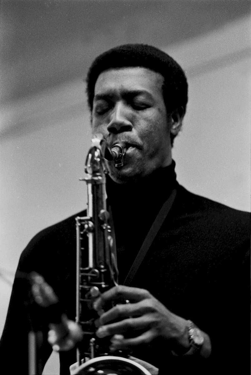 Billy Harper, tenor Saxophonist, performing with the Lee Morgan Quintet, at the Jazz Showcase, located at  I.W.W. Hall, in Chicago. 1970. Photo By Ozier Muhammad