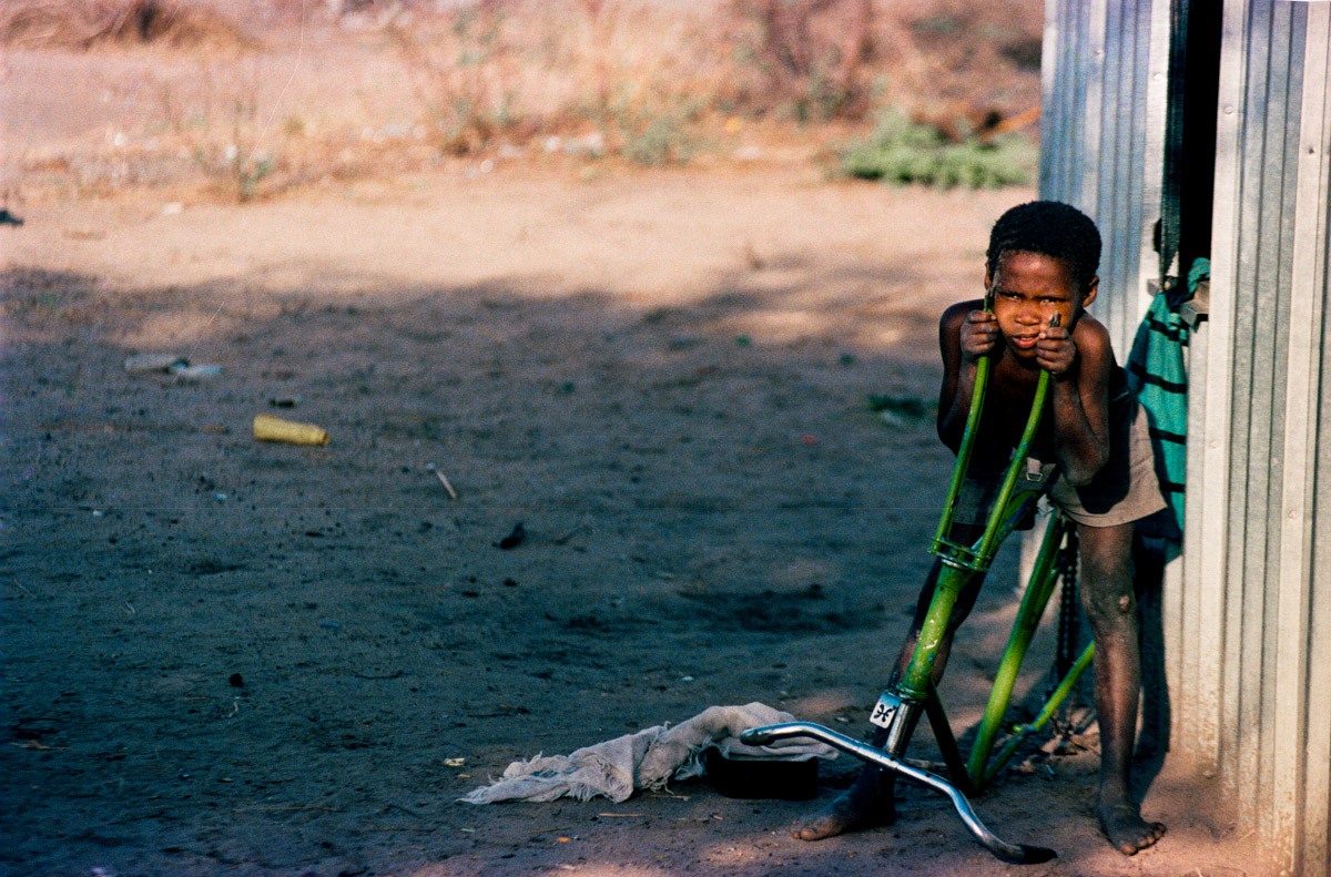 A boy and a junked bicycle.