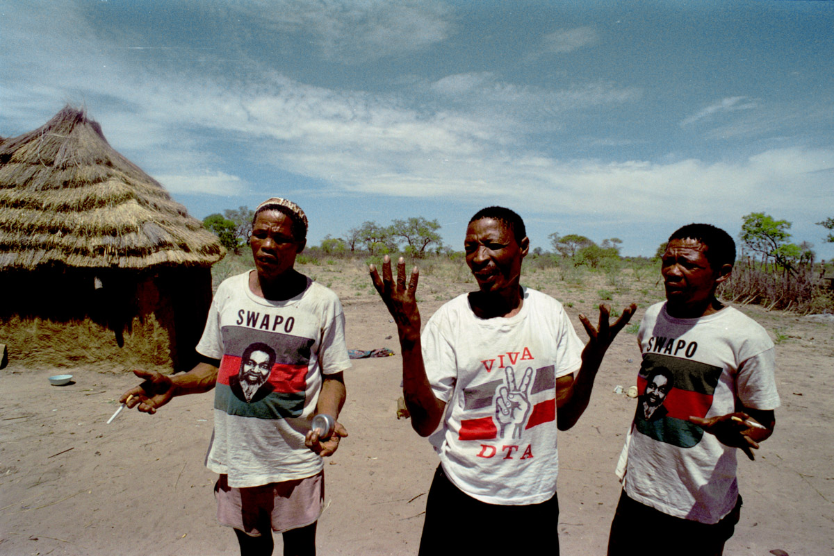 These men talk politics. This was a period of national voting for independence from South Arica and Germany.