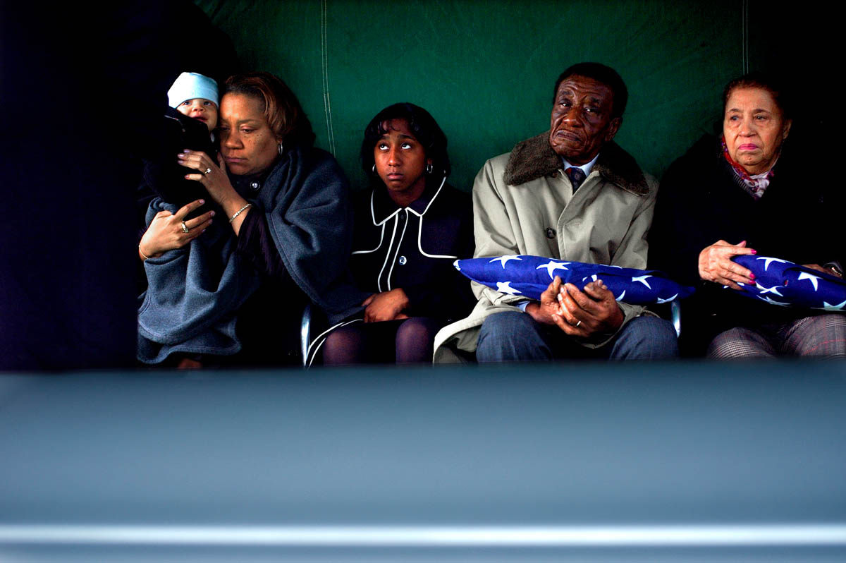 Oct. 2006 - Cleveland, OH - Jordan King, and his mother Dana Canedy look on the casket of the remains of his father and her fiance, Sgt. Charles King, killed in Iraq. His parents look on from the right of photo. - Ozier Muhammad / NYT