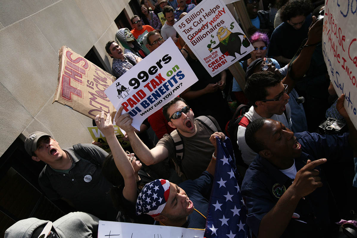 The Occupy Wall Street Protest shout {quote}we are the 99%{quote} outside the home of Jamie Dimon, the C.E.O. of Chase Bank.