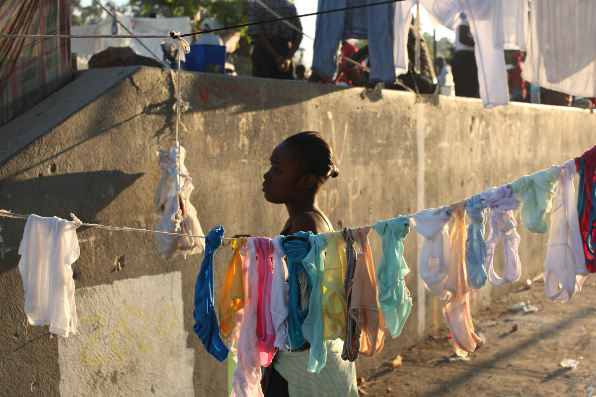 Port Au Prince, Haiti, This woman hangs a clothes to dry on a line in an area of Champ de Mars park in the city center. She is one of hundreds who have built tent cities in this park after the devasting earthquake on January 12th destroyed their homes.Photo by Ozier Muhammad/The New York Times