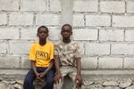 01-25-10  Port Au Prince, Haiti - Deskl: FOR - Slug: - ORPHANS  -  Jhon-derson Dade, 11, with his brother Judeson, 12. - Ozier Muhammad/The New York Times