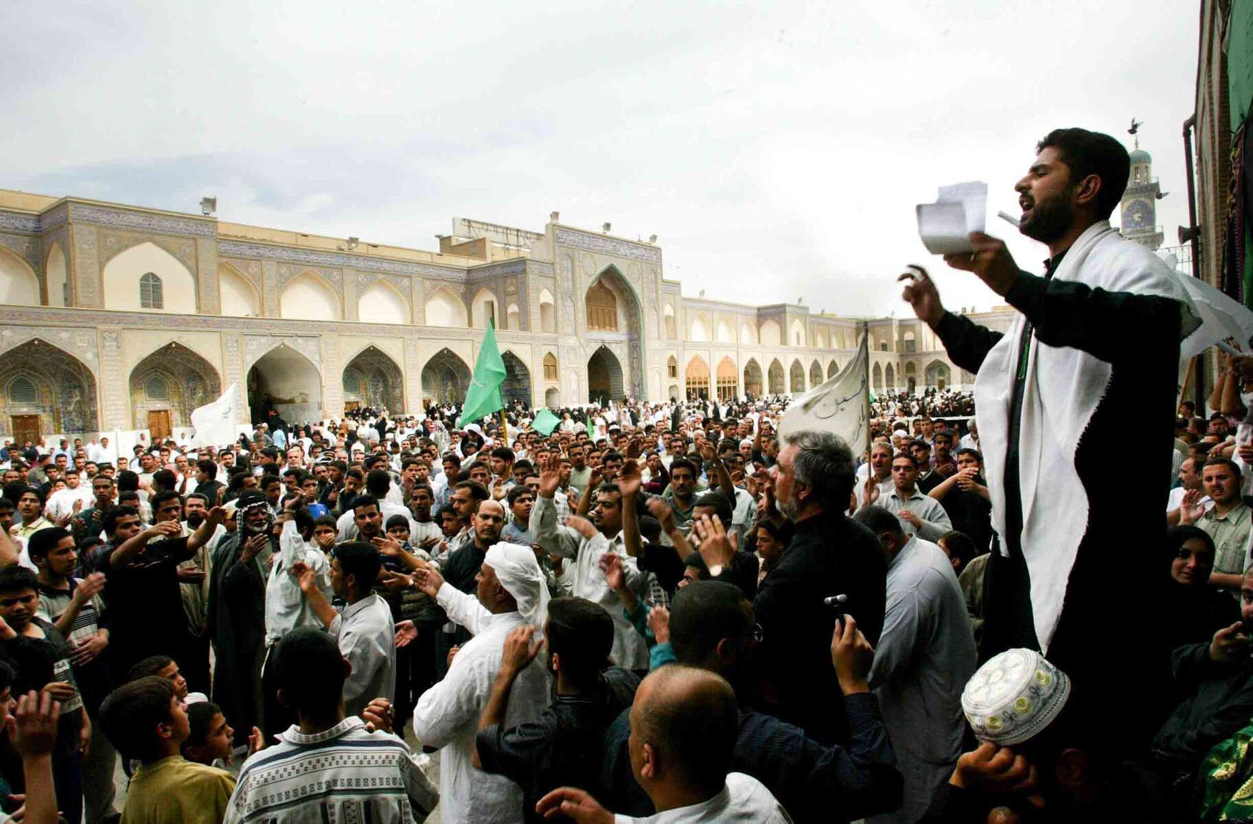 April, 2003 - Shia Muslims gathered in a Baghdad masjid to listen to Quranic recitations and respond according to the sacred rituals that are obligatory for believers to perform in the sacred month of Muharrum. - Ozier Muhammad / NYT