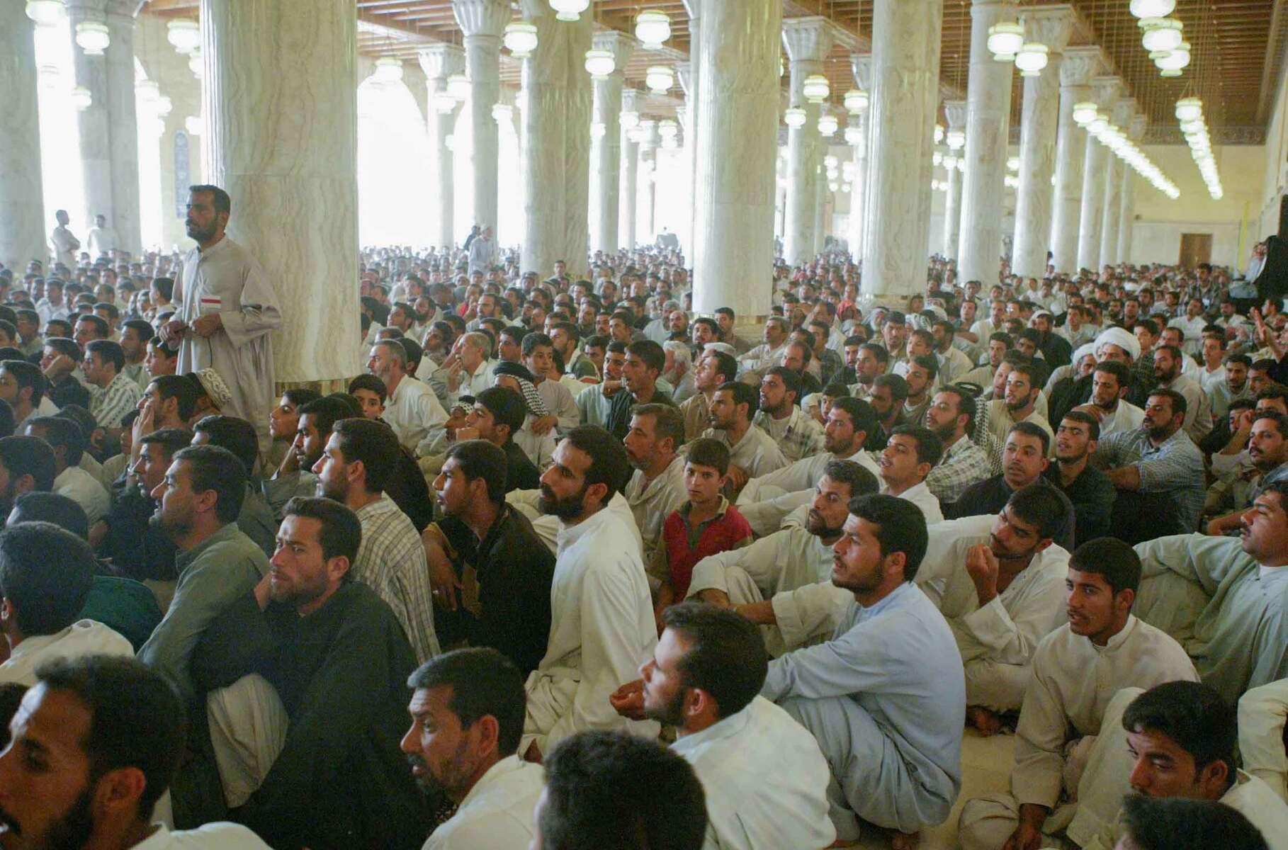 Najaf, Iraq -  Hundreds of  Shia muslims gathered for Jumah prayer and sermon. The Iman who lead Friday prayers was Muqtada al_Sadr, who is a very influential cleric in Iraq. This gathering is at the  Imam Ali Holy Shrine.  - Ozier Muhammad / NYT