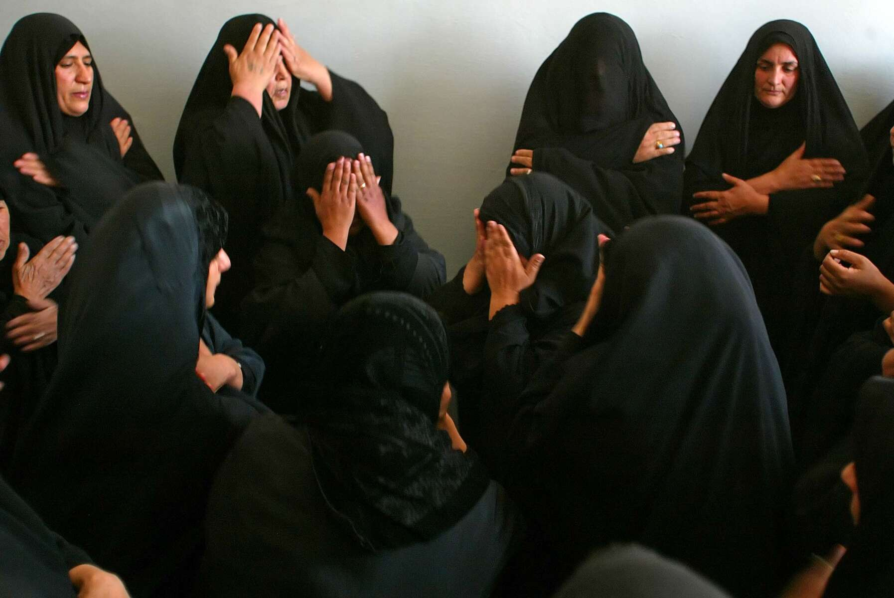 Najaf, Iraq -  Shia muslim women strike their foreheds  just outside the tomb of Ali, at  the Imam Ali Holy Shrine.  - Ozier Muhammad / NYT