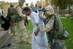 April, 2003. - Marines Headquarters Division - The marines begin detaining some Iraqis who allegedly had  stolen ancient artifacts from the Baghdad Museum not long after U.S. forces arrived here. - Ozier Muhammad / NYT