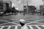 Patterns of white at Martin Luther King and Malcolm X boulevards crossing in Harlem.