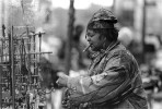 March, 1993 - Katirah Hikmah, a jewelry, incense and trinkets vendor, finishes preparing her sells display on 125th street.