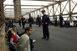 More than 700 Occupy Wall Street demonstrators were arrested when they defied an order not to march in the roadways of the Brooklyn Bridge.