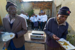 More than 100 senior citizens gathered at The Nelson Mandela Heritage Site here to celebrate Mandela Day. Food, and music was provided by a non-profit organization called Tshedbedisano Support Network. A group of volunteers from a banking concern posed in front of the brick bungalow, in which Nelson Mandela lived when he left the Eastern Cape to move to the greater Johannesburg vicinity in the early 40s. The day was defined as a day to commit oneself to volunteer, to help others for at least 67 minutes, in recognition of the sacrifices Mandela made in his struggle with others, against apartheid over the course of 67 years.