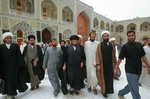 Najaf, Iraq - Muqtada al-Sadr (center), a Shite clerical leader has tremendous influence among the predominantly Shia Islamic community of Iraq. Al-Sadr arrving the Imam Ali Holy Shrine.  - Ozier Muhammad / NYT
