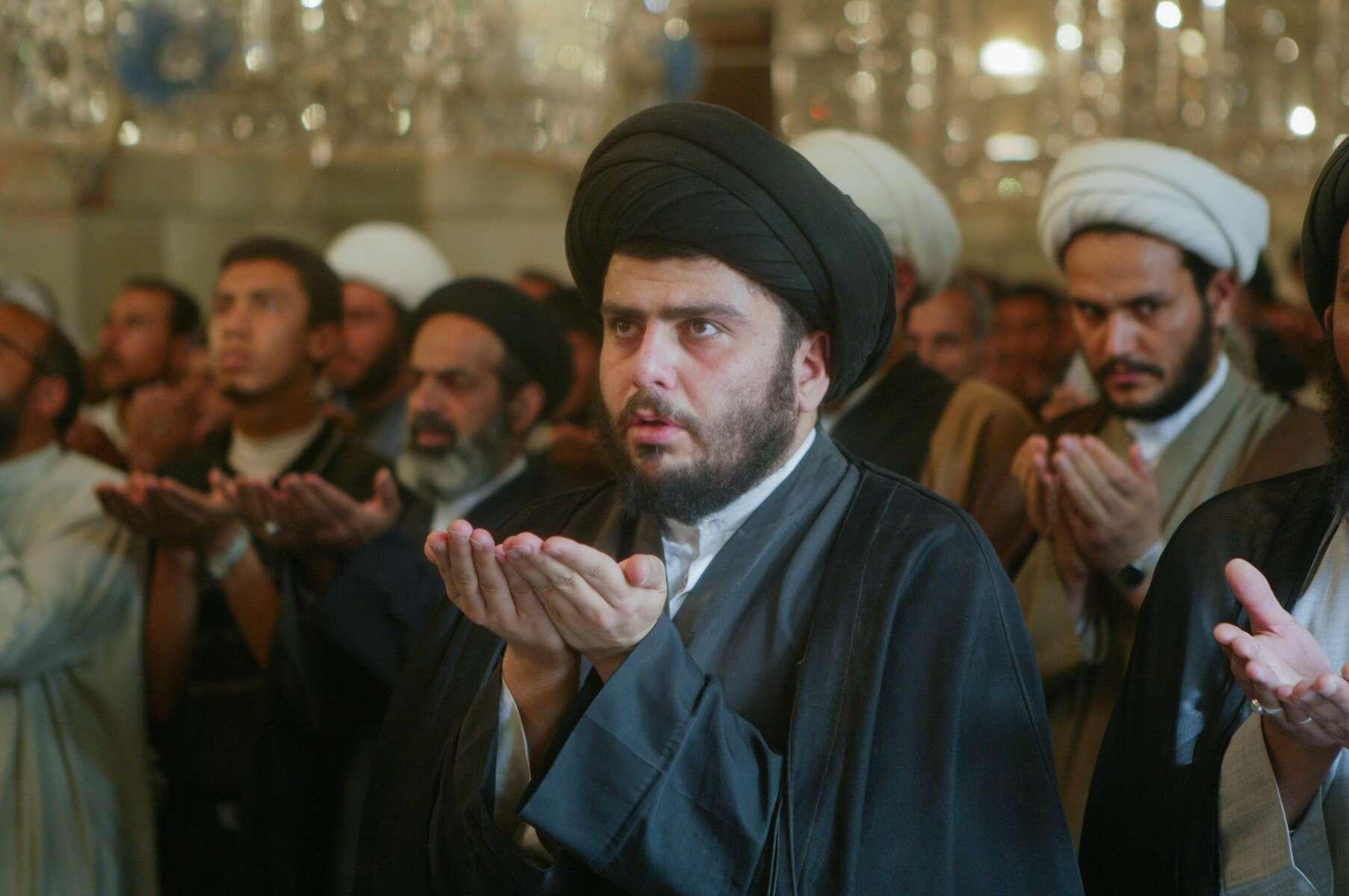 Najaf, Iraq - Muqtada al-Sadr (2nd from right) a Shite clerical leader who  has tremendous influence among the predominantly Shia Islamic community of Iraq,  prayers at  the Imam Ali Holy Shrine.  - Ozier Muhammad / NYT