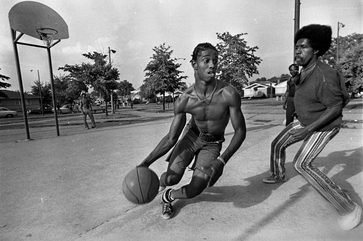 Young men playing pickup basketball in Martin Luther King Jr. Park on the Southside.