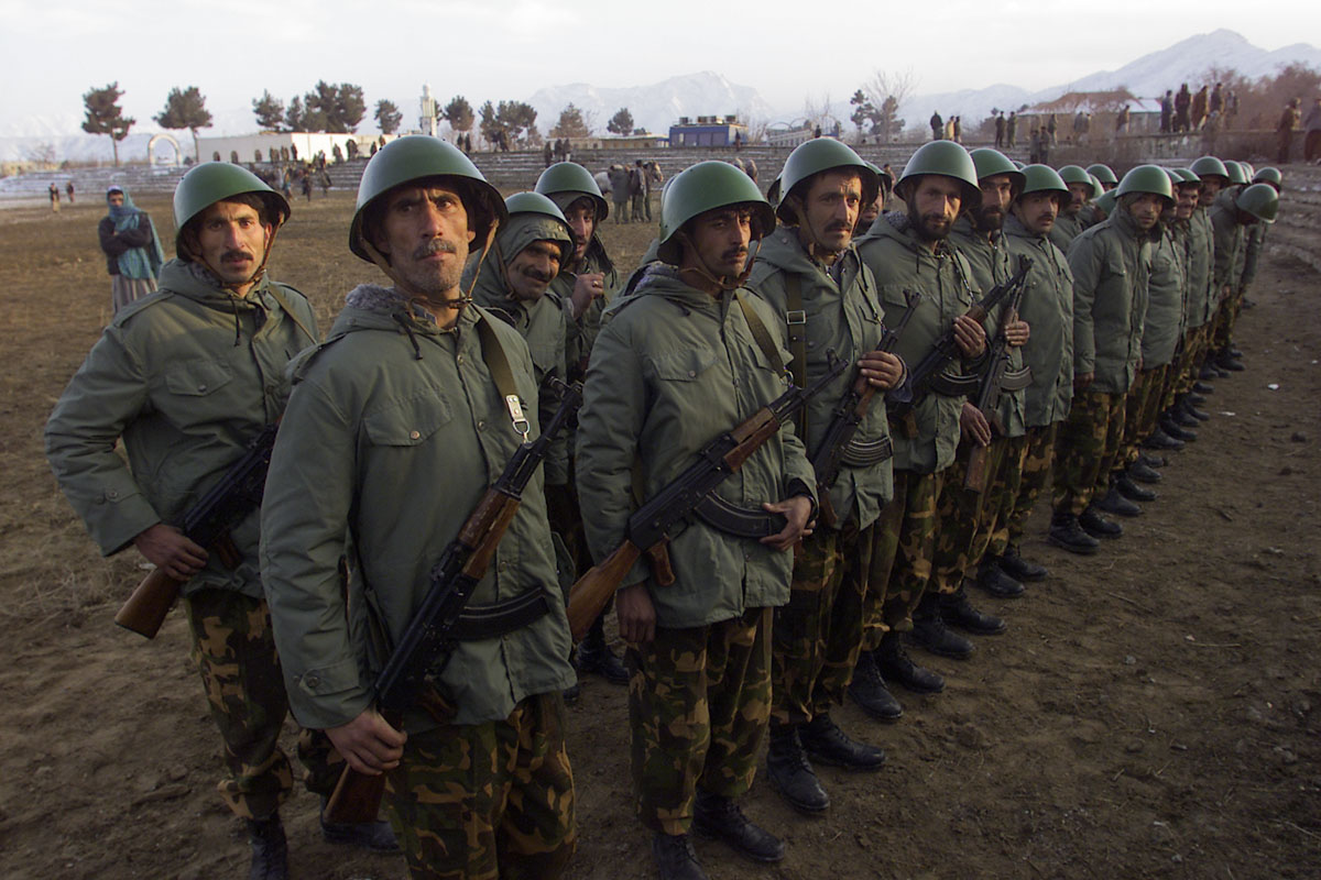 02/10/02   Kabul, Afghanistan - FOR - Slug:  KARZAI ARMY'S - A fledgling Afghanistan army lineup to run through some military drills at National Olympic stadium in Kabul.  (digital) Ozier Muhammad/The New York Times