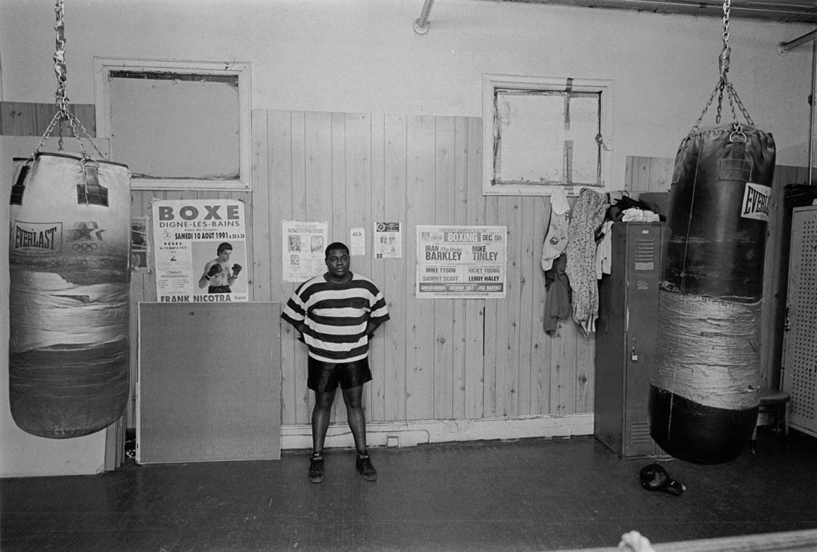 April, 1993 - An aspiring boxer takes a break during training at Connie Bryant's boxing gym in Harlem.