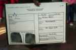 07-05-2013 - A file card indicates charges South Africa's Apartheid Government brought against this prisoner. Billy Nair was charged with Sabotage.