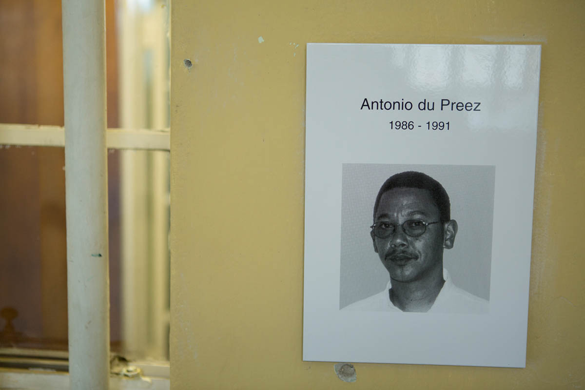 07-05-2013 - Photo of Antonio Du Preez, who was imprisoned here in this cell from 1986 to 1991 for political reasons. He mentioned in the journal letter that he wrote that  the Robben Island Museum committee collect and later posted. The Museum writes:  Du Preez was serving the 15 plus years he was sentenced to, for the charge of subversive acts against the South African Government. Upon his arrival here, he refers to an encounter in a letter posted inside this cell in which du Preez wrote:   'an old man, said to me upon my arrival here, {quote}how are you comrade?{quote} That old man was Mandela.'
