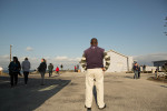 07-05-2013 - A former political prisoner, now tour guide, keeps watch of his tour group as they take a look at Cape Town from here.