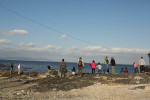 07-05-2013 - A tour group looks towards Cape Town from the grounds of this former prison.