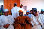 Newly elected president of Nigeria, Olusegun Obasanjo (center), with former heads of state and Yacuba Gowan in a jovial mood before Mr.Obasanjo addressed the nation for the first time since his victory.
